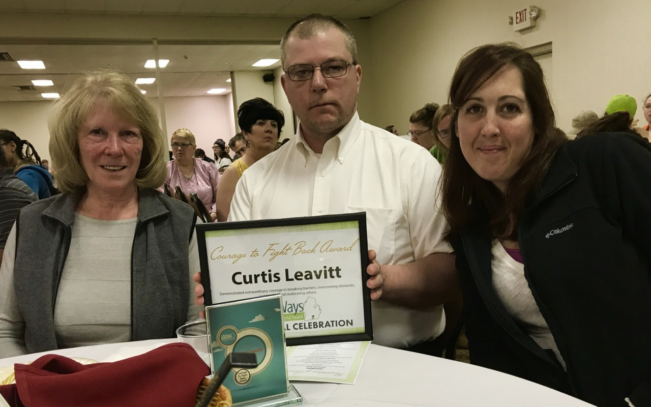 Curtis L. with his certificate